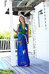 Beautiful mature woman in blue dress walking on deck