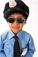 Boy Dressed as Police Officer Stock Photo - Premium Royalty-Freenull, Code: 600-02786813