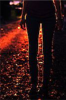 Silhouette of Woman Standing Outdoors at Dusk    Stock Photo - Premium Rights-Managednull, Code: 700-02786842