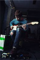 Young Man Playing Guitar Stock Photo - Premium Rights-Managednull, Code: 700-02786867