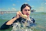 Businessman in the Ocean Talking on Telephone    Stock Photo - Premium Rights-Managed, Artist: Nathan Jones, Code: 700-02786875