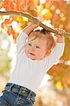 Baby Girl Hanging onto Branch    Stock Photo - Premium Rights-Managed, Artist: Tomasz Rossa, Code: 700-02791581