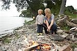 Mother and Toddler Roasting Marshmallows on a Rocky Beach, Prince Edward County, Ontario, Canada Stock Photo - Premium Rights-Managed, Artist: Derek Shapton, Code: 700-02791661
