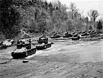1940s WORLD WAR II 12 U.S. ARMY TANKS ON MANEUVERS CROSSING A RIVER STREAM ARMORED WEAPON