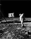 1969 ASTRONAUT US FLAG AND LEG OF LUNAR LANDER ON THE SURFACE OF THE MOON