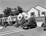 1950s SUBURBAN STREET OF TYPICAL HOMES QUEENS NEW YORK