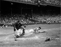 professional baseball game - 1950s PROFESSIONAL MAJOR LEAGUE BASEBALL GAME RUNNER SLIDING INTO HOME BASE AS UMPIRE SIGNALS SAFE    Stock Photo - Premium Rights-Managednull, Code: 846-02792062
