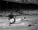 1950s PROFESSIONAL MAJOR LEAGUE BASEBALL GAME RUNNER SLIDING INTO HOME BASE AS UMPIRE SIGNALS SAFE    Stock Photo - Premium Rights-Managed, Artist: ClassicStock, Code: 846-02792062