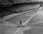 1950s BASEBALL PLAYER SCORING HOME RUN AS HE STRIDES ACROSS HOME PLATE    Stock Photo - Premium Rights-Managed, Artist: ClassicStock, Code: 846-02792091
