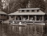 1950s TWO WOMEN PADDLING IN CANOE BY CABIN IN LAKE ALGONQUIN PARK CANADA SUMMER CAMP RUSTIC LOG CABIN    Stock Photo - Premium Rights-Managed, Artist: ClassicStock, Code: 846-02792229