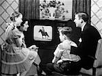 FAMILY IN FRONT OF TELEVISION