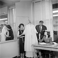 1950s FEMALE FASHION BUYER SELECTING LINGERIE CLOTHING IN A GARMENT INDUSTRY SHOWROOM    Stock Photo - Premium Rights-Managednull, Code: 846-02792526