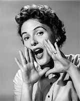 1950s CHARACTER WOMAN SHOUTING HANDS CUPPING MOUTH YELLING ANNOUNCEMENT LOOKING AT CAMERA    Stock Photo - Premium Rights-Managednull, Code: 846-02792983
