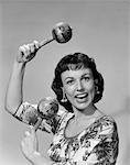 1950s WOMAN PORTRAIT PLAYING MARACAS