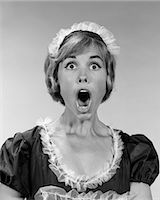 1960s WOMAN IN MAID UNIFORM EYES AND MOUTH WIDE OPEN FLABBERGASTED INDOOR    Stock Photo - Premium Rights-Managednull, Code: 846-02793079