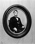 PORTRAIT OF PRESIDENT ABRAHAM LINCOLN SEATED TAKEN BY MATTHEW BRADY IN 1864 IN BLACK OVAL WOOD PICTURE FRAME
