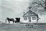 1970s AMISH ONE-ROOM SCHOOLHOUSE AT TOP OF HILL HORSE & BUGGY & BICYCLES PARKED OUTSIDE    Stock Photo - Premium Rights-Managed, Artist: ClassicStock, Code: 846-02793306