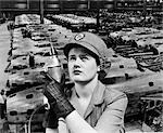 WOMAN ROSIE THE RIVETER SUPERIMPOSED OVER AIRPLANES IN FACTORY 1940s WARTIME WWII WORKER WORK