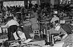 1940s SWEATSHOP WITH WORKERS SEWING