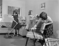 1950s THREE PRE-TEEN YOUNG GIRLS CLEANING LIVING ROOM DUSTING VACUUMING    Stock Photo - Premium Rights-Managednull, Code: 846-02793615
