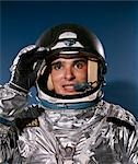 PORTRAIT OF MAN IN SILVER ASTRONAUT SUIT STUDIO