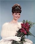 1960s YOUNG WOMAN WEARING CROWN WHITE FUR STOLE GLOVES HOLDING BOUQUET OF RED ROSES