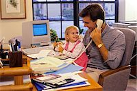 1990s FATHER WITH YOUNG DAUGHTER IN HOME OFFICE WITH APPLE MAC CLASSIC COMPUTER    Stock Photo - Premium Rights-Managednull, Code: 846-02794336