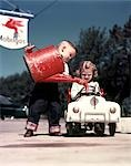 1950s LITTLE BOY PRETENDING TO SERVICE PEDDLE TOY CAR FIRE ENGINE FOR LITTLE GIRL