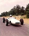 1960s LOTUS FORD SPORTS RACE CAR AND DRIVER WEARING HELMET AND GOGGLES RACING    Stock Photo - Premium Rights-Managed, Artist: ClassicStock, Code: 846-02794611