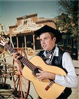 saloon - 1960s MAN PLAYING ACOUSTIC GUITAR COWBOY SALOON IN BACKGROUND    Stock Photo - Premium Rights-Managednull, Code: 846-02794691