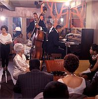 1960s AFRICAN AMERICAN JAZZ TRIO AND BLACK AUDIENCE PLAYING IN NIGHT CLUB LOUNGE    Stock Photo - Premium Rights-Managednull, Code: 846-02794708