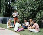 1960s 1970s GROUP 6 TEENAGERS OUTDOORS BOYS GIRLS PLAYING GUITARS BONGO DRUMS