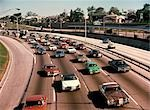 1970 1970s TRAFFIC KENNEDY EXPRESSWAY CHICAGO IL EXPRESS LANE PARALLEL COMMUTER TRAIN TRACKS COMMUTERS