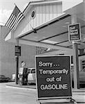 1970s SORRY TEMPORARILY OUT OF GASOLINE SIGN AT SELF SERVICE GAS STATION DURING 1973 OPEC OIL SHORTAGE CRISIS