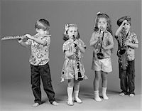 TWO BOYS AND TWO GIRLS PLAYING FLUTE CLARINET TRUMPET AND SAXOPHONE INDOOR    Stock Photo - Premium Rights-Managednull, Code: 846-02795399