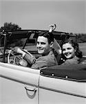1940s 1941 SMILING COUPLE MAN WOMAN ON A DATE SITTING IN PONTIAC CONVERTIBLE AUTOMOBILE
