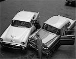 1950s 1960s AUTOMOBILE FENDER BENDER ACCIDENT IN PARKING LOT