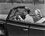 1940s COUPLE DRIVING CAR CONVERTIBLE DATE