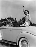 1940s COUPLE CAR DRIVING CONVERTIBLE SMILE WAVING