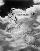 1930s MONTAGE BABY SITTING ON TOP OF THE WORLD EARTH GLOBE IN CLOUDS HOLDING HAPPY NEW YEAR BANNER    Stock Photo - Premium Rights-Managednull, Code: 846-02795683