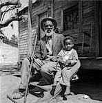 1930s ELDERLY MAN GRANDFATHER SIT PORCH SHACK WITH GRANDSON BOY    Stock Photo - Premium Rights-Managed, Artist: ClassicStock, Code: 846-02795740