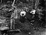 1890s 1900s GROUP OF TWO MEN & TWO WOMEN IN WOODS ONE MAN & ONE WOMAN DRINKING