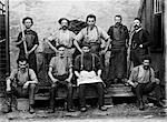 1890s 1900s GROUP PORTRAIT OF 9 CARPET MILL WORKERS