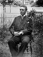 1890s 1900s TURN OF THE CENTURY PORTRAIT OF MAN IN THREE-PIECE SUIT SEATED IN CHAIR OUTSIDE    Stock Photo - Premium Rights-Managednull, Code: 846-02795912