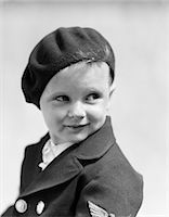 1930s STUDIO PORTRAIT OF YOUNG BOY LOOK TO THE SIDE WEARING A BERET AND A DOUBLE BREASTED JACKET    Stock Photo - Premium Rights-Managednull, Code: 846-02796183