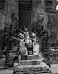 1920s 1930s 3 YOUNG FEMALE TEMPLE DANCERS ON STEPS OF ANCIENT TEMPLE FOLK DANCE TRADITIONAL COSTUME