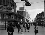 1930s PEOPLE STROLLING STREET SCENE TOKYO THEATER STREET