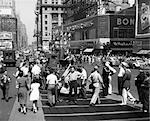 1940s WWII WARTIME TIMES SQUARE MANHATTAN PEDESTRIANS TRAFFIC TWO SAILORS NEAR MODEL OF NAVY SHIP RECRUITING STATION