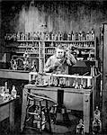 DRAWING GENIUS INVENTOR THOMAS A. EDISON AT WORK IN HIS LABORATORY IN MENLO PARK NEW JERSEY USA