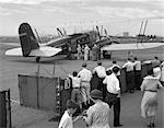 1930s PASSENGERS BOARDING AMERICAN AIRLINES CONDOR BIPLANE AIRPLANE FOR COMMERCIAL FLIGHT FROM NEWARK NEW JERSEY USA AIRPORT